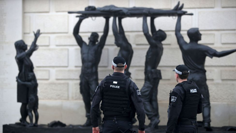Police in front of one of Ian Rank-Broadley's sculptures at the National Memorial Arboretum