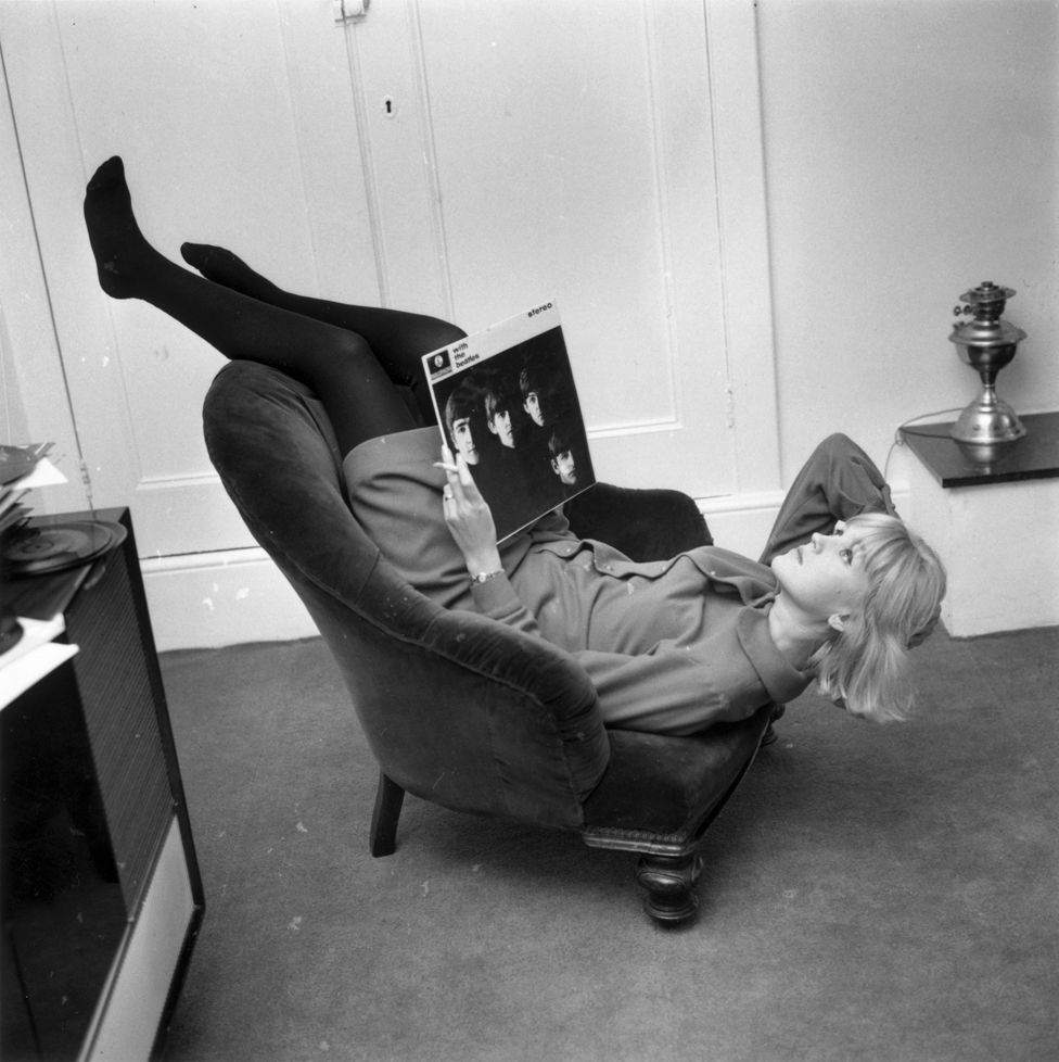 Annie Nightingale relaxing with a Beatles album in 1964