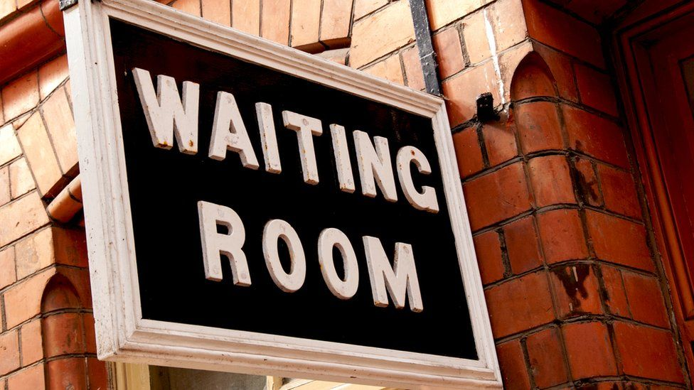 A waiting room sign
