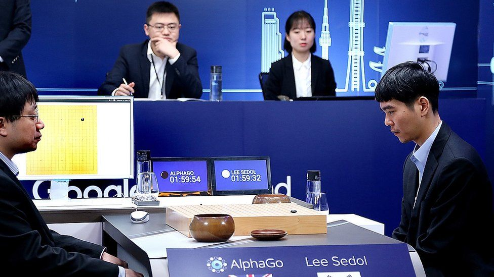 South Korean professional Go player Lee Se-Dol (R) prepares for his fourth match against Google's artificial intelligence program, AlphaGo, during the Google DeepMind Challenge Match