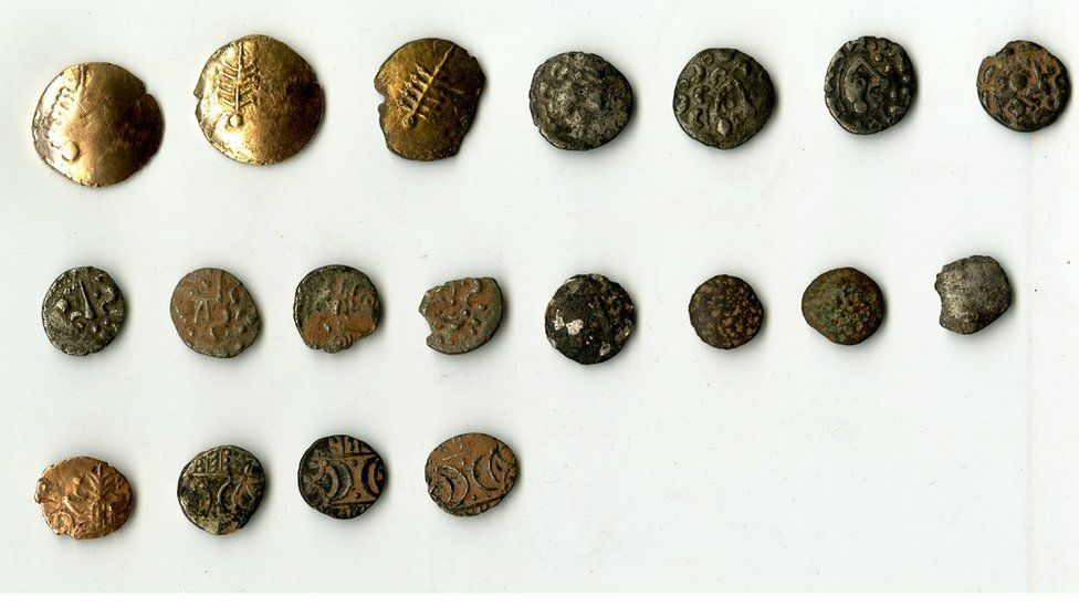 The full hoard of 19 coins, the bottom four are the coins believed to have come from another area