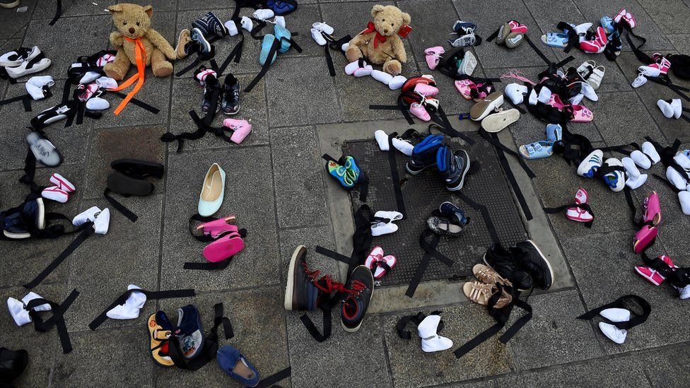 children's shoes laid on ground in Dublin