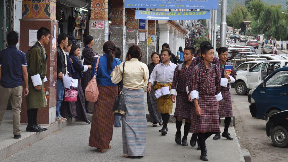 People walk in the street in Thimphu, capital of Bhutan (file photo)