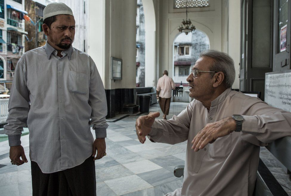 Farooq speaks with a local Muslim man at the Shia Mughal Mosque in downtown Yangon, Myanmar, November 19, 2015