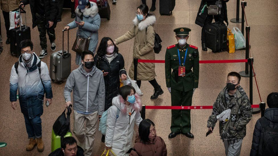 A Chinese police officer at a Beijing railway station.