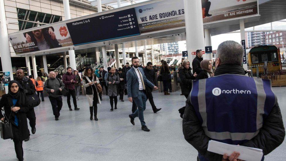 Rail passengers at Manchester Victoria train station