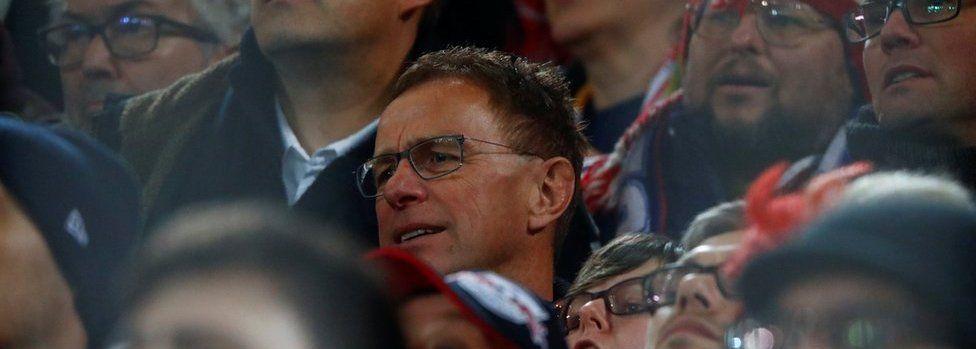 RB Leipzig sports director Ralf Rangnick (C) watches the Dortmund match among Leipzig fans on 4 Feb