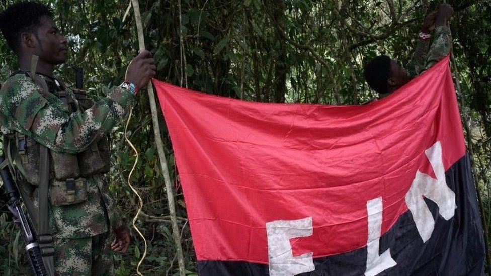 Rebels of the National Liberation Army (ELN) hold a banner in the north-western jungles in Colombia, August 30, 2017.