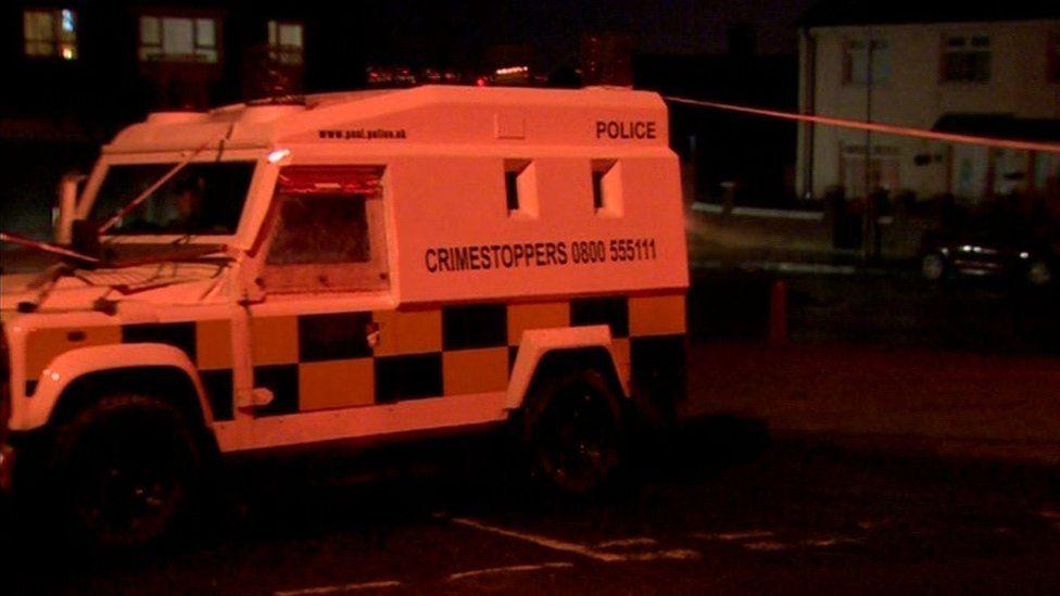 Police vehicle at scene of Monagh Road gun attack