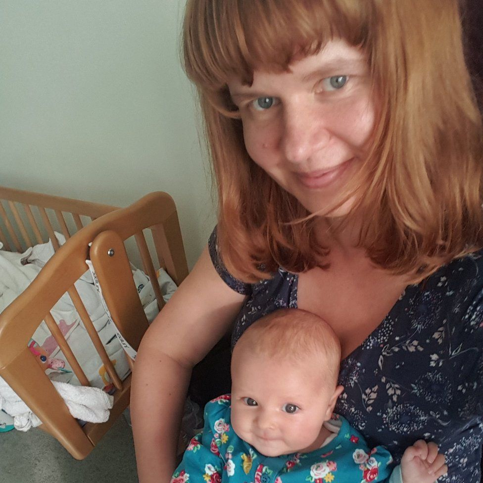 Tania Ash holding her baby daughter Marie