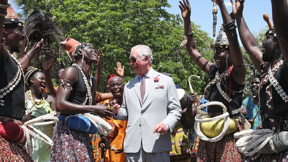 Prince Charles, Prince of Wales is greeted by traditional dancers during a tour of Christiansborg Castle on November 3, 2018 in Accra, Ghana
