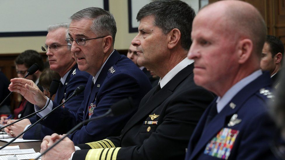 Gen John Hyten and other military figures address a Congressional hearing in March 2017.
