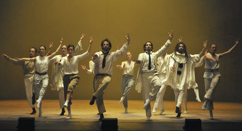 Artists perform in Sun a production of Hofesh Shechter company