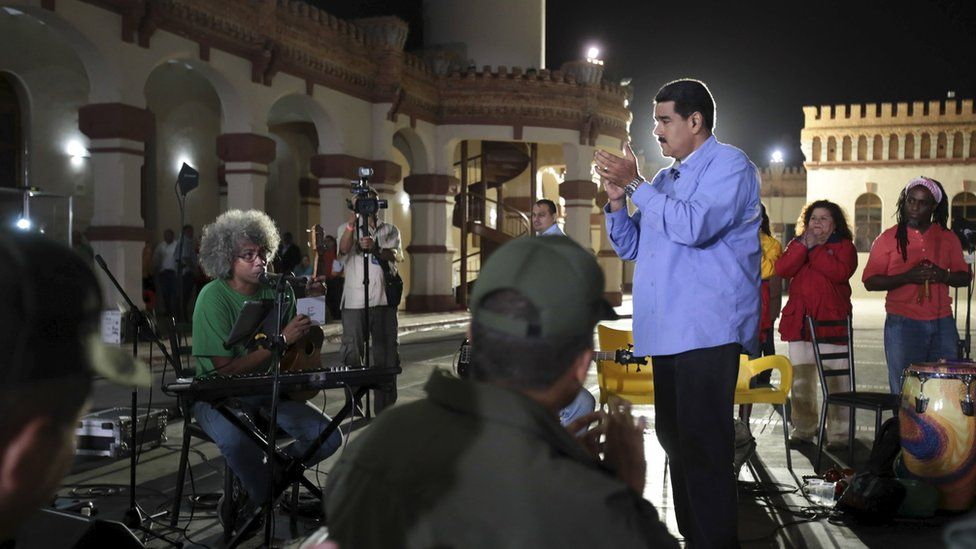"""President Nicolas Maduro applauds during his weekly broadcast """"en contacto con Maduro"""" (In contact with Maduro) in Caracas"""