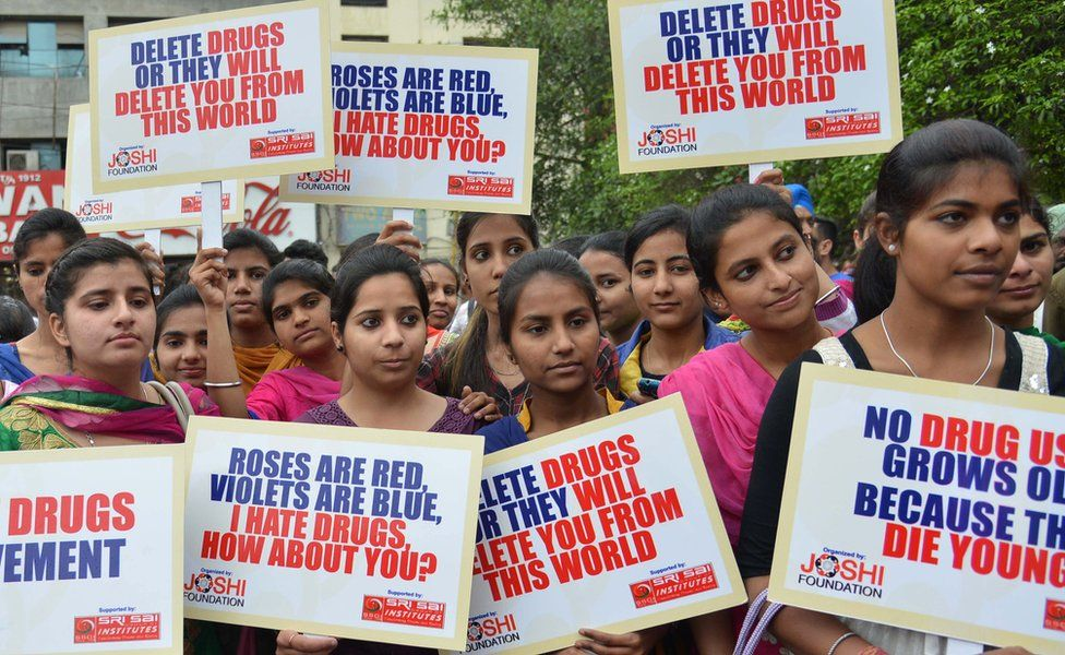 Indian students hold placards as they participate in an anti-drugs awareness march organized by the Joshi Foundation in Amritsar on April 7, 2015.