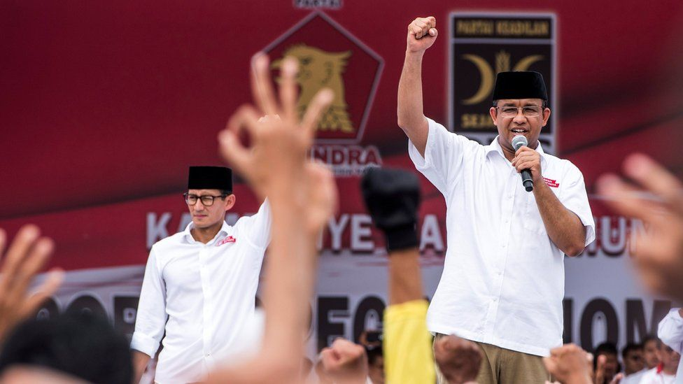 Anies Baswedan (right), a candidate in the running to lead the Indonesian capital Jakarta, and his deputy Sandiaga Uno stand in front of their supporters during campaigning in Jakarta, Indonesia, February 5, 2017.