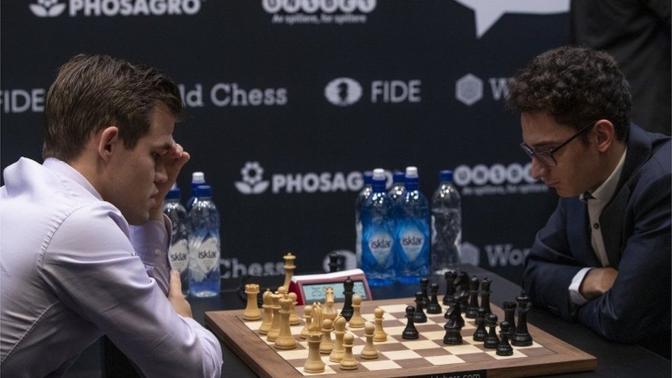 Magnus Carlsen, left, and Fabiano Caruana playing chess