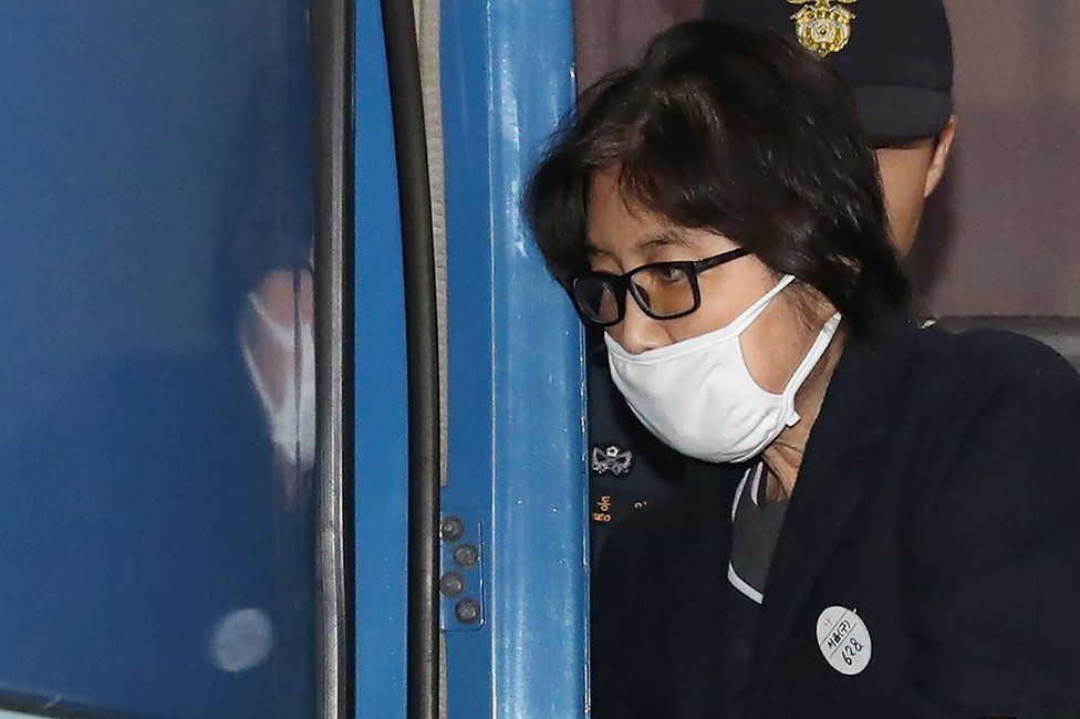 "This picture taken on 19 November 2016 shows Choi Soon-sil, the woman at the heart of a lurid political scandal engulfing South Korea's President Park Geun-Hye, being escorted after questioning at the Seoul Central District Prosecutors"" Office in Seoul."