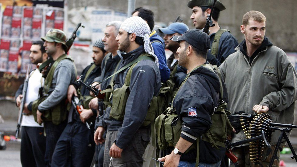 Shiite gunmen pause in the streets of Beirut on May 9, 2008.