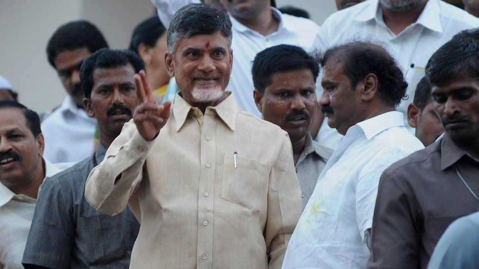 Indian Telugu Desam Party President N.Chandra Babu Naidu (C) gestures as he greets his supporters after winning in the Indian election at his residence in Hyderabad on May 16, 2014