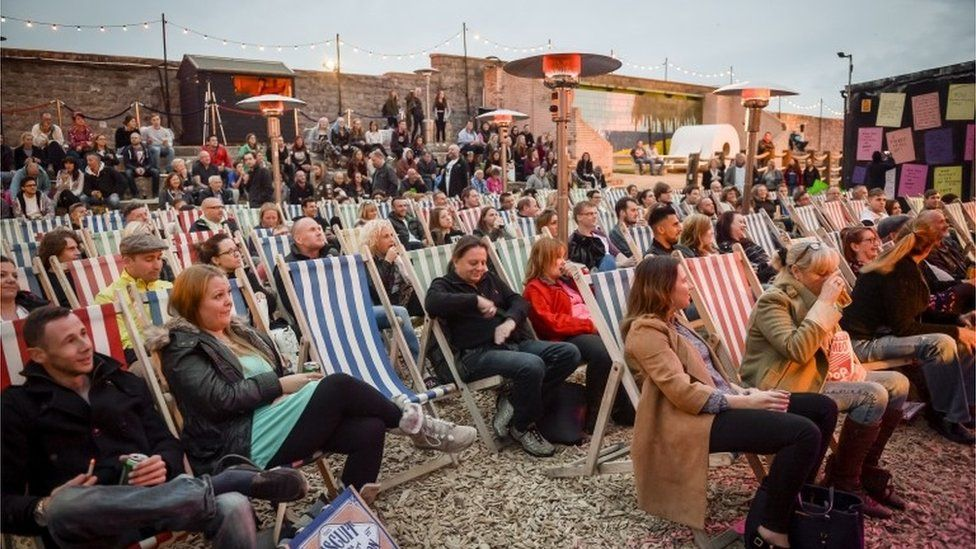 Crowds watching comedy evening at Dismaland