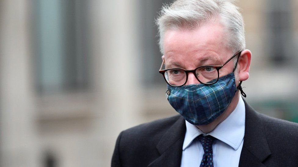 Michael Gove in a tartan mask