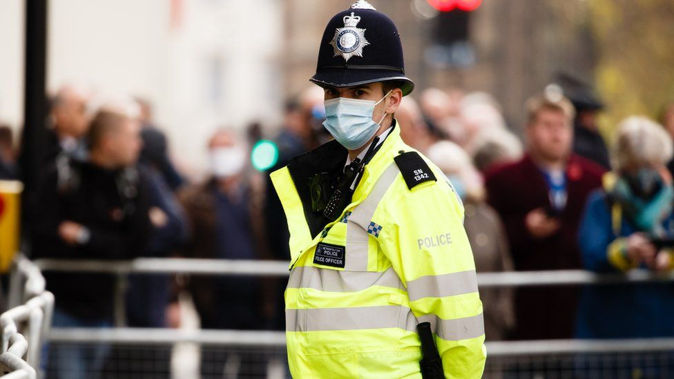 Police officer wearing a mask