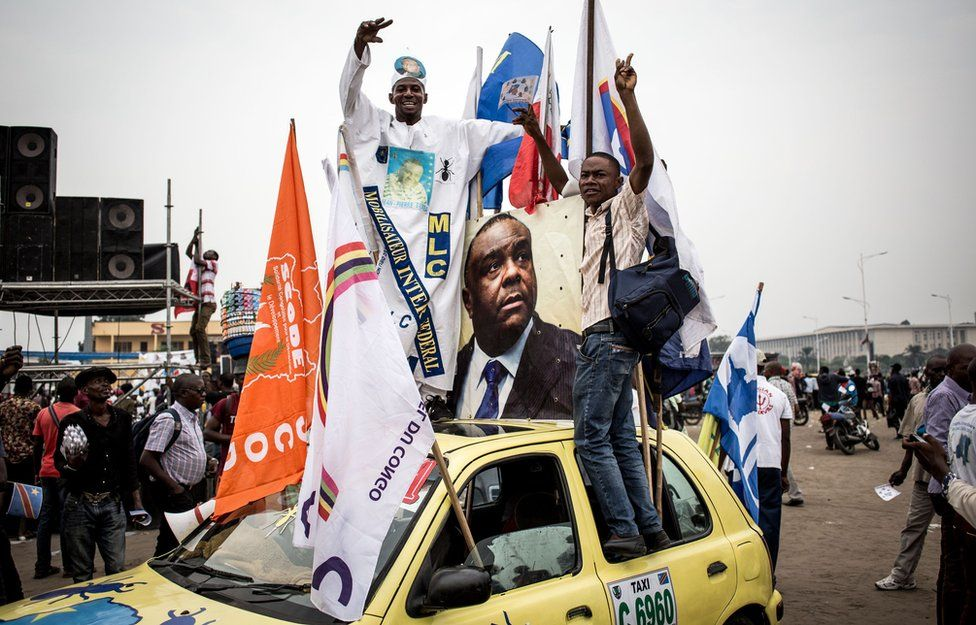 Supporters celebrate ahead of an opposition rally where the main opposition presidential candidates will address supporters three months before the upcoming elections on September 29, 2018 in Kinshas