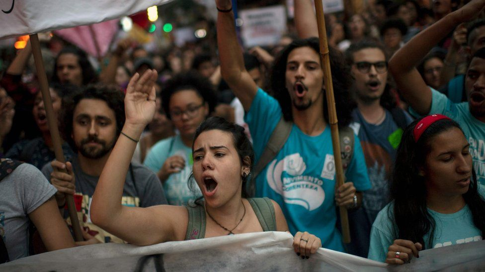 "Women shout slogans during a protest against President Jair Bolsonaro""s education budget cuts"