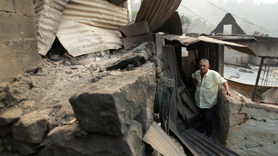 Avelino Viveiros studies his fire-damaged home at Curral dos Romeiros in Funchal, Madeira island, Portugal 10 August 2016