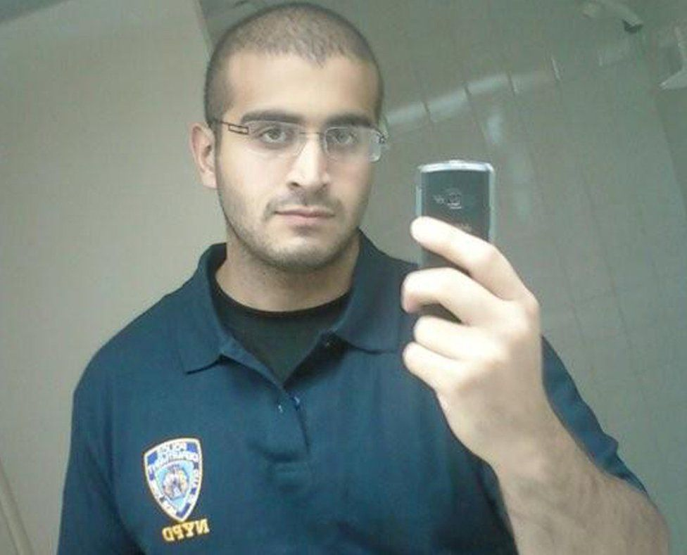 Undated photo of Omar Mateen wearing a t-shirt with NYPD emblem