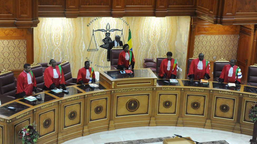 President of Gabonese Constitutional Court Marie-Madeleine Mborantsuo (C) takes her seat ahead of hearing in Libreville on September 22, 2016.