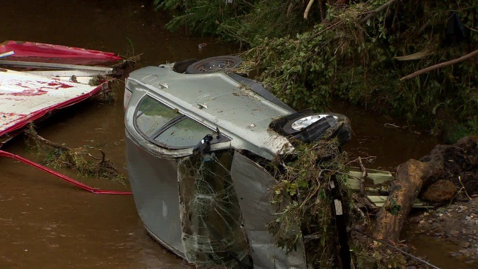 Cars rescued from river