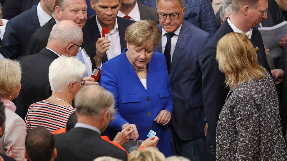 Parliamentarians, including German Chancellor Angela Merkel (C, in blue) cast their ballots to vote at the Bundestag on a new law to legalize gay marriage in Germany on June 30, 2017 in Berlin, Germany.