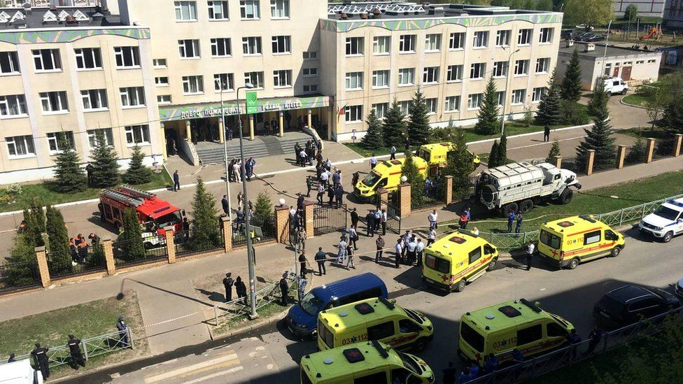 Ambulances and other emergency services vehicles outside the school in Kazan, Russia, 11 May 2021