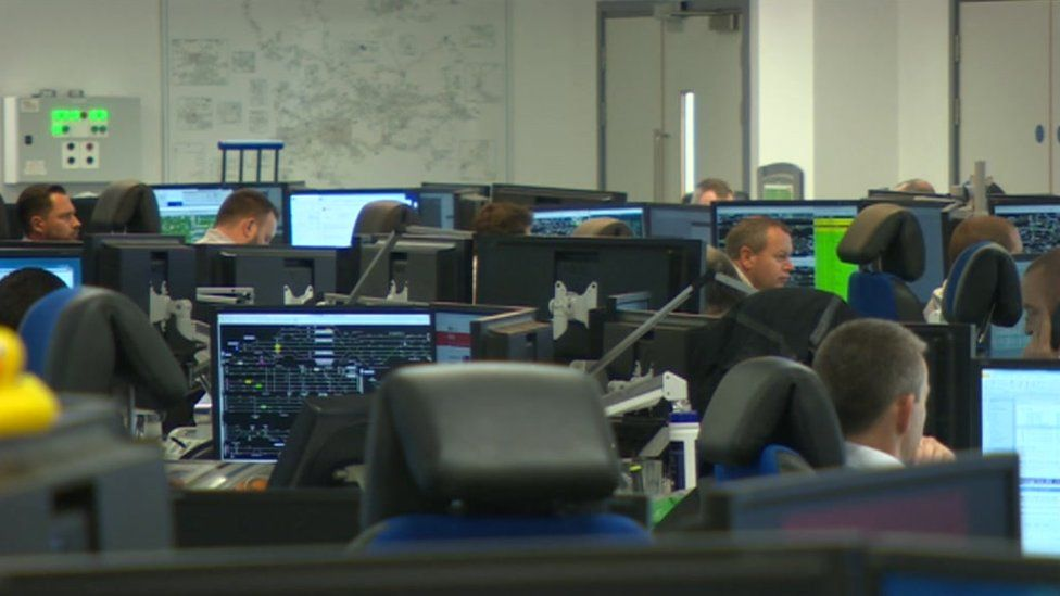 People working in a computerised office