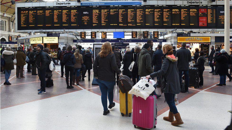 Passengers at London Victoria railway station