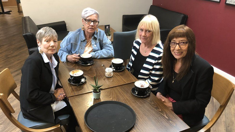 Four sisters around a coffee table