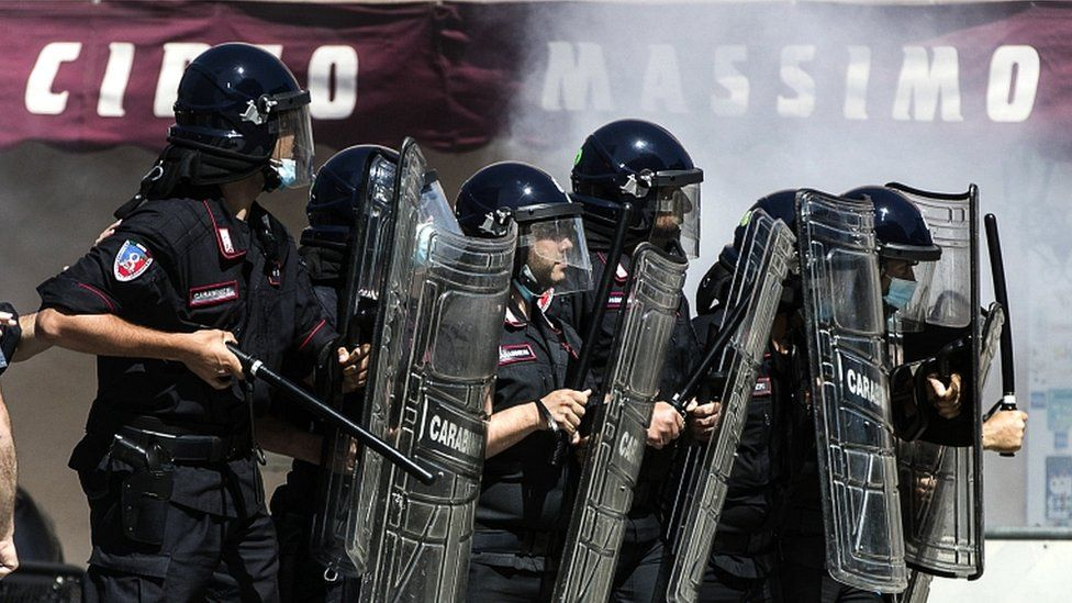 """Neo-fascist groups, extremists and ultras from Italy's football clubs clash with police as they demonstrate over the government""""s handling of the coronavirus emergency, on 6 June 2020 at Circus Maximus in Rome"""
