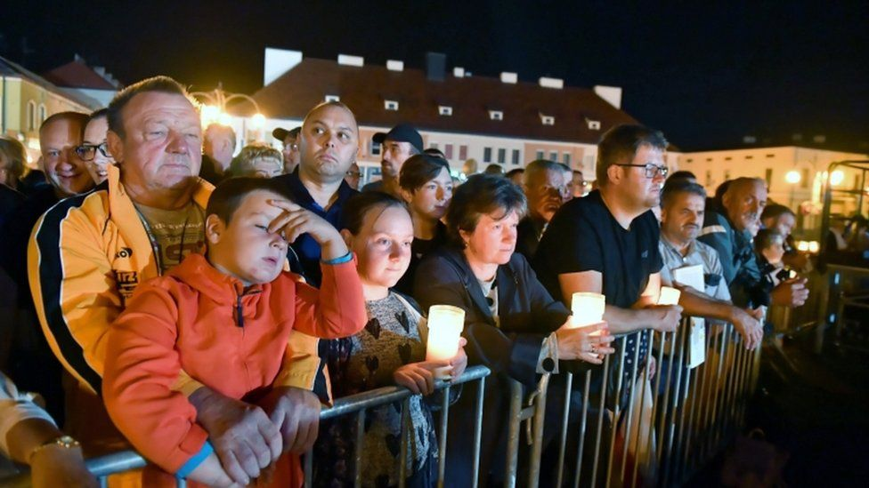 People held candles to mark the occasion at the ceremony in the city of Wielun, Poland