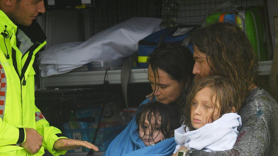 A family is rescued after their boat capsized as they were being evacuated from a flooded property at Upper Colo in north western Sydney,