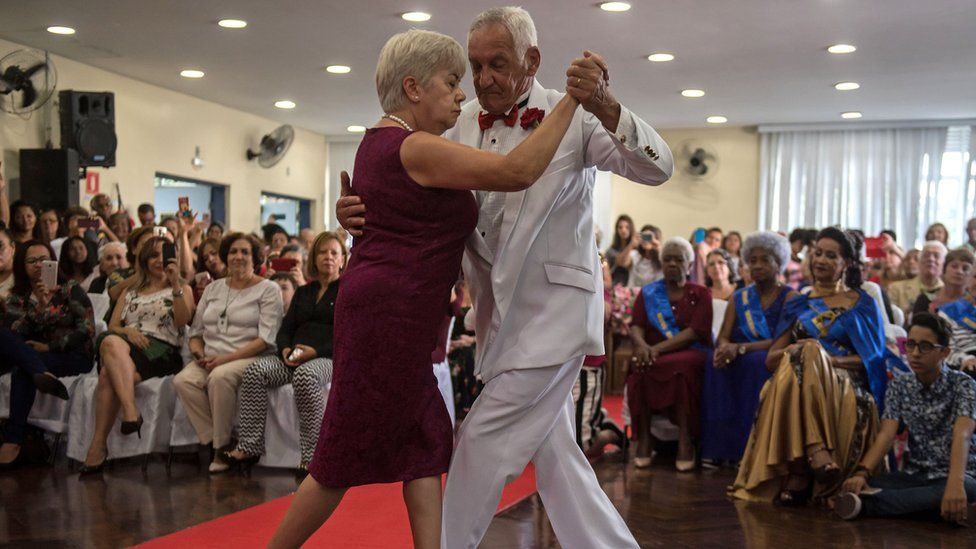 Pensioners dance at a beauty pageant for elderly women ahead of Mother's Day, in Sao Paulo, Brazil on May 10, 2018