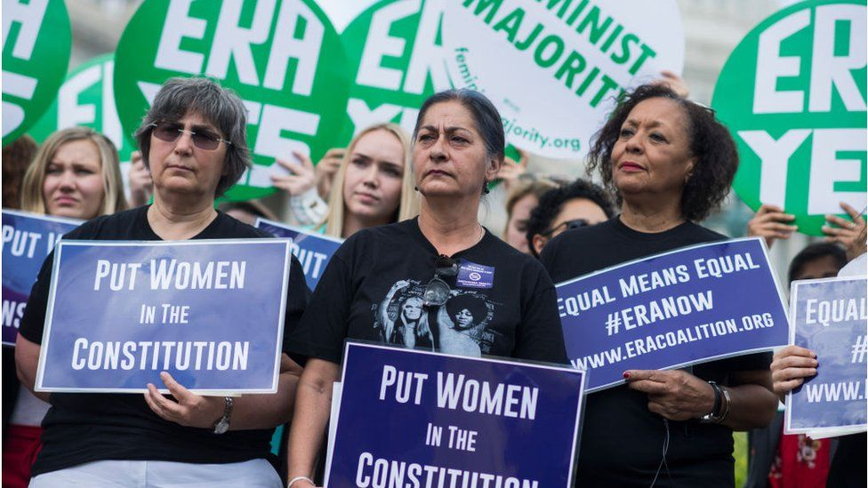 Jessica Lenahan, center, a domestic violence survivor, and Carol Jenkins, right, of the Equal Rights Amendment Task Force, attend a news conference at the House Triangle on the need to ratify the Equal Rights Amendment on June 6, 2018.