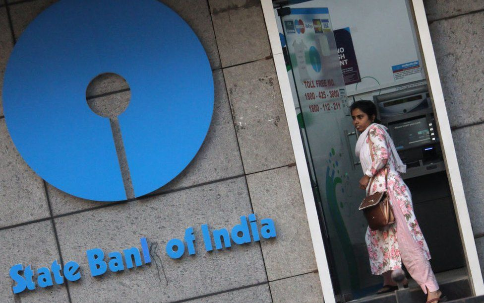 A woman walks out of an ATM of State Bank of India (SBI) in Mumbai, India on 07 February 2020.