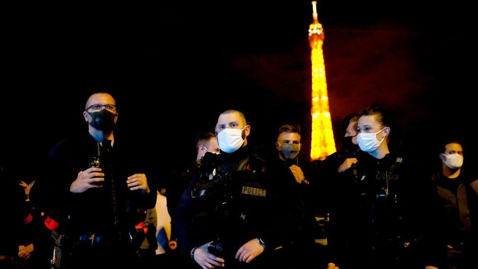 French police officers protest at Trocadero square in front of the Eiffel Tower in Paris on June 14, 2020, in reaction to the French Interior Minister's latests announcements following demonstrations against police violence