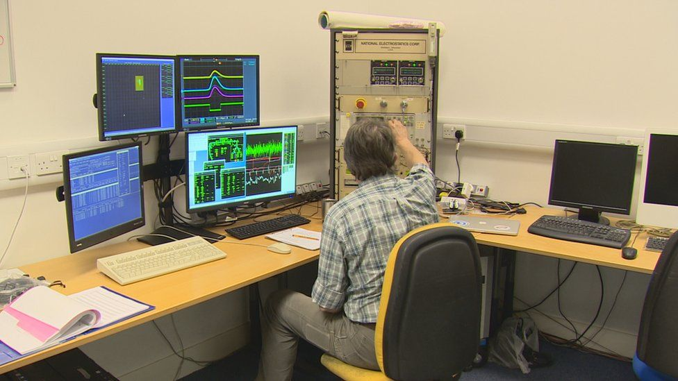 Scientists in the laboratory's control room monitor traces of the Carbon-14 atoms