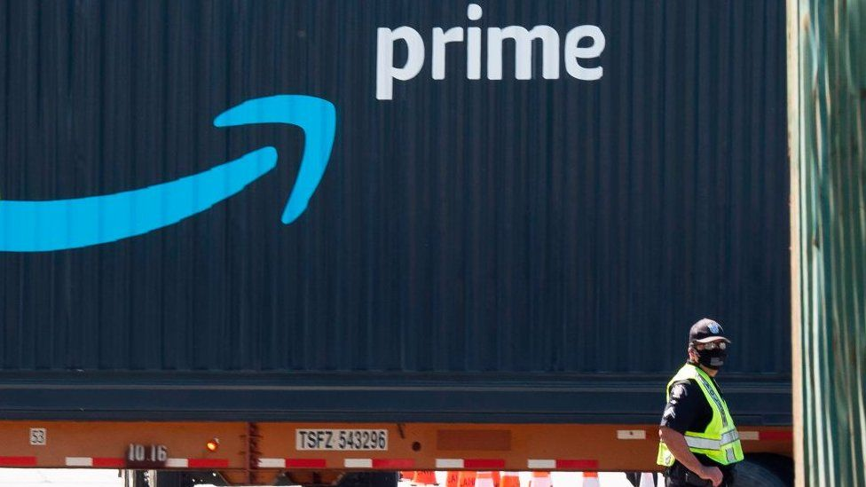 An Amazon Prime delivery truck drives through the Port of Los Angeles and Long Beach, California.