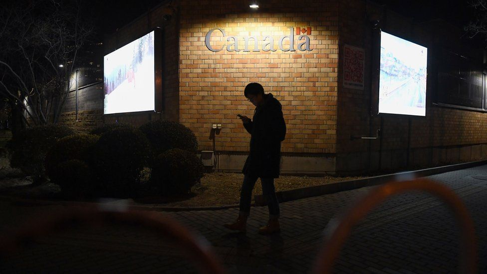 A man walks past the Canadian embassy in Beijing