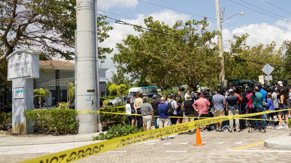 City officials and medical staff address the media outside Rehabilitation Center at Hollywood Hills in Florida where eight residents were found dead, 13 September 2017