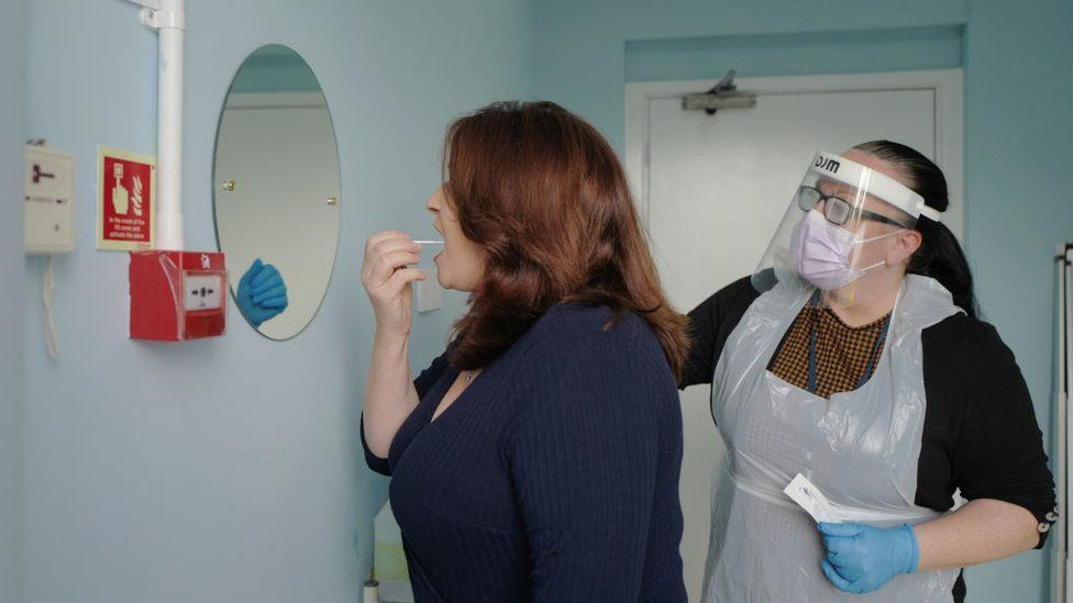 Woman taking a covid test in a care home